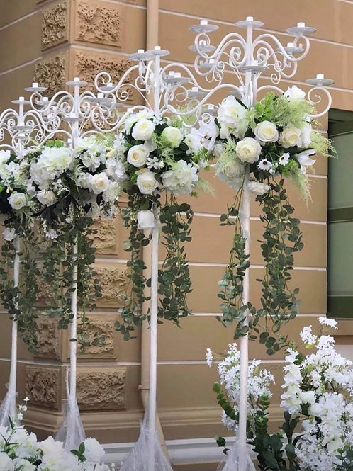 white candelabra , chandelier including flowers for hire.