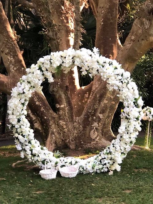 white flower circle arch .