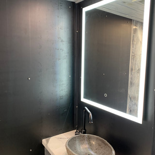 Converted interior bathroom sink and mirror