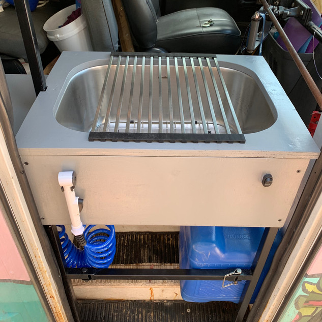 Surf bus with wash sink