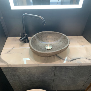 Converted interior bathroom sink and counter top