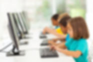 group elementary school students in computer class.jpg