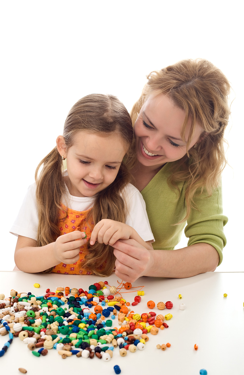 Girl Lacing Beads with Mother Helping