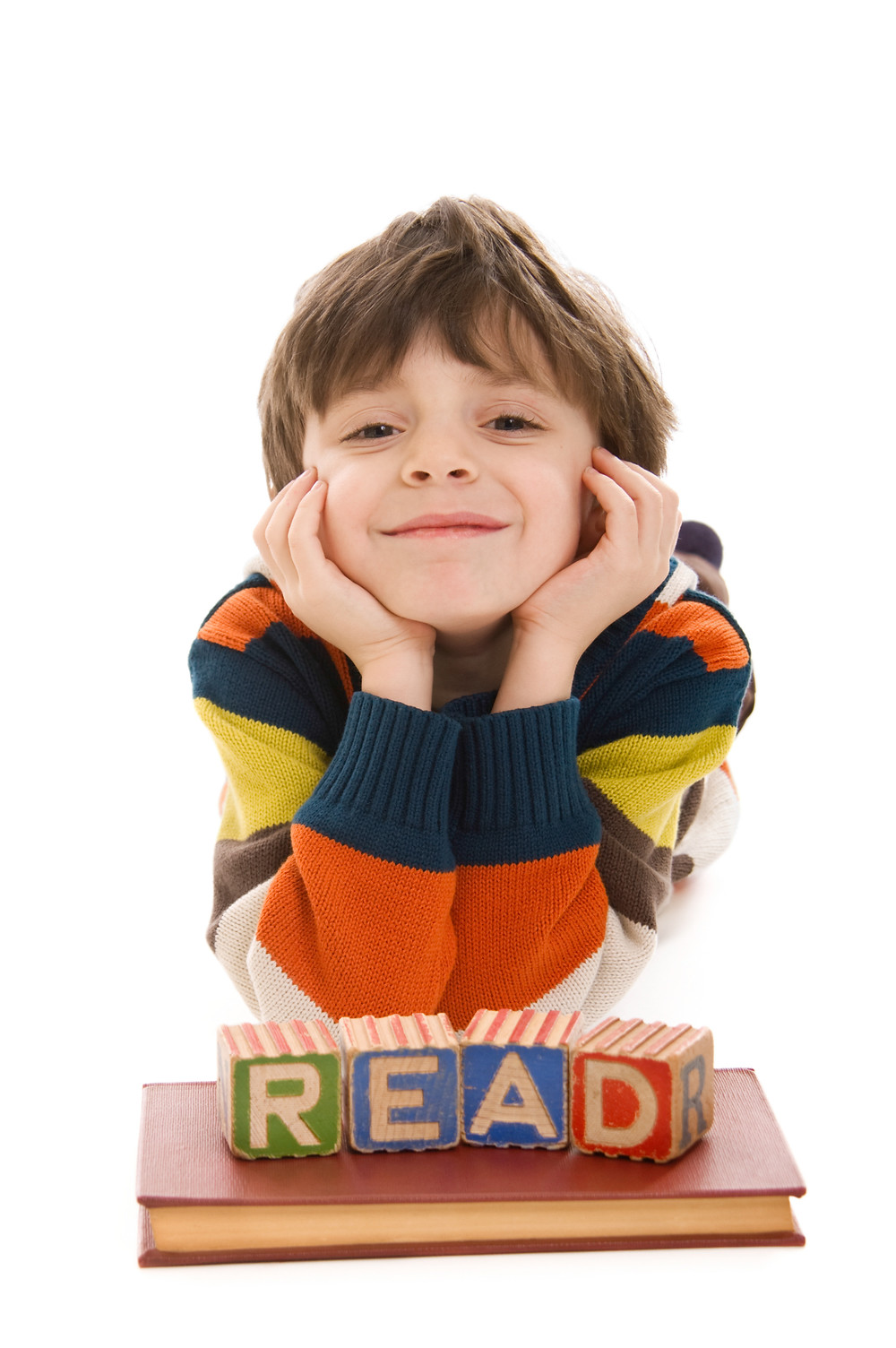 "Child with ""READ"" blocks in educational therapy"