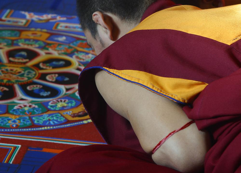 Tibetan Buddhist Monk creating a mandala