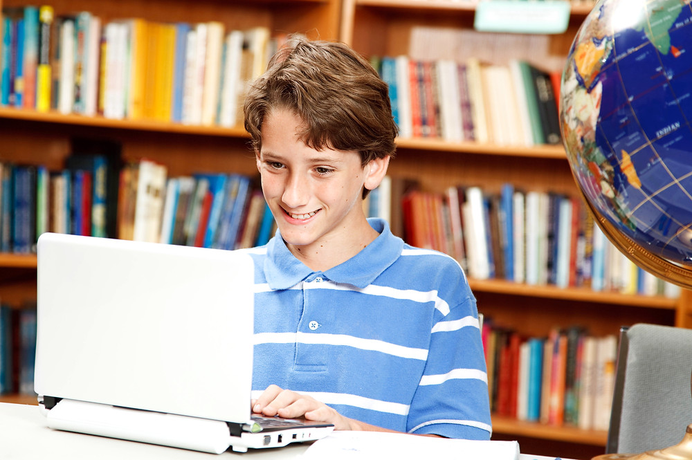 boy typing after educational therapy