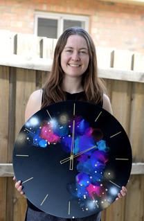 Defy Gravity Commission Clock