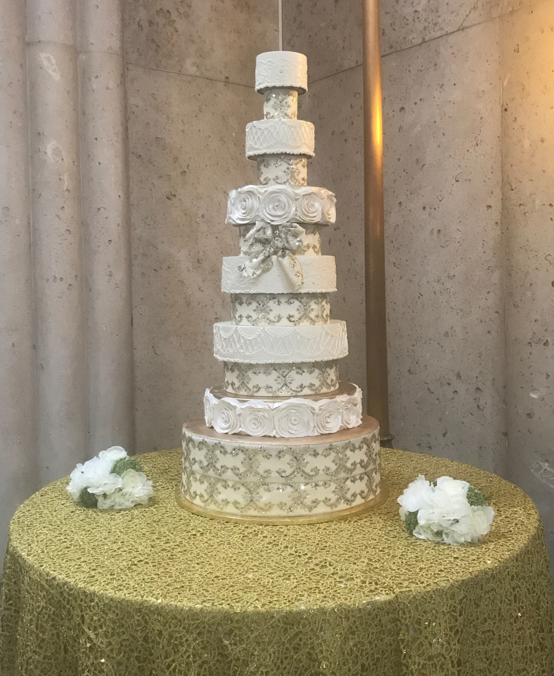 gold ribbon tower cake.jpg