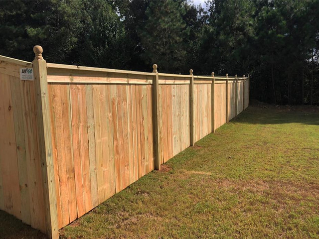 PT WOOD PRIVACY FENCE WITH CAPPED TOP AN