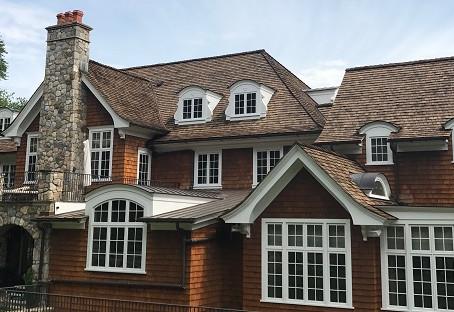 Cedar Roofs vs. Metal Roofs