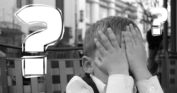 Child covering face after mistake