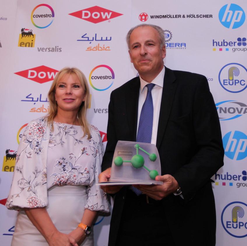 EU Commissioner Elżbieta Bieńkowska handing over the main award to Stefan Sommer, President of Vynova Group