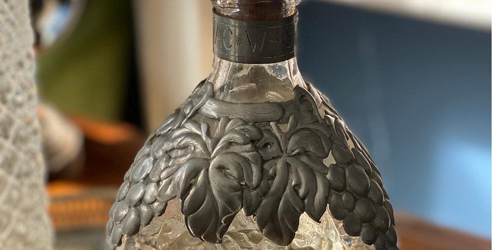 Antigua botella de whisky Sandy Mac