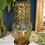 Thumbnail: Vaso con botellita ámbar