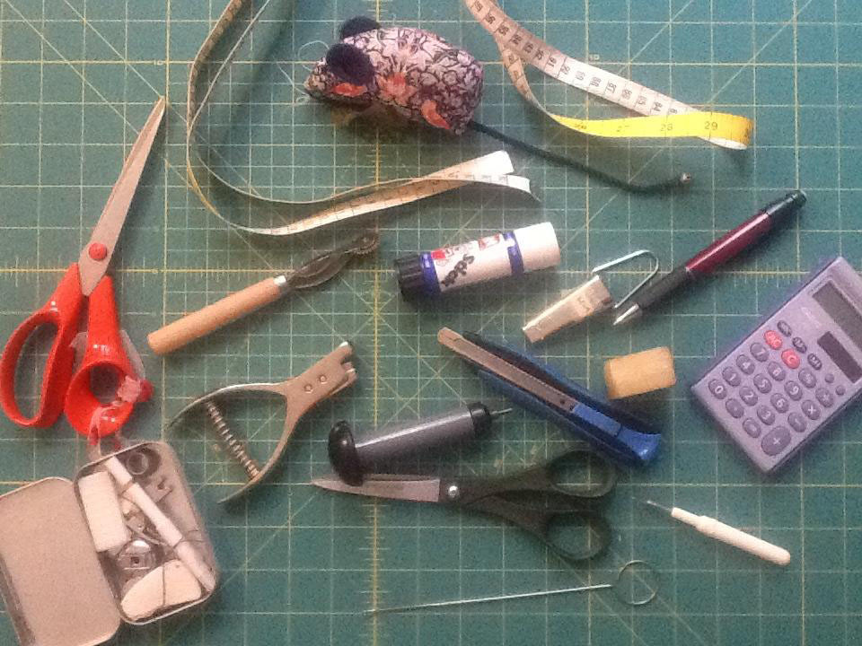 the main tools I use for pattern cutting and sample making including the cutting mat.