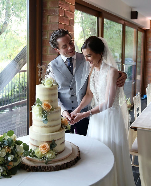 Semi-naked wedding cake at Old Brook Barn
