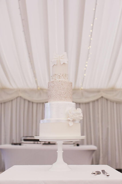 Tall silver leaf glitter wedding cake