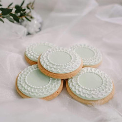 Mint coloured wedding favour biscuit