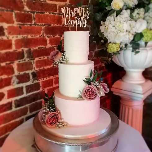 Blush rustic textured buttercream wedding cake