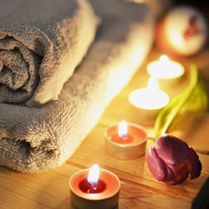 gray towel and tealights