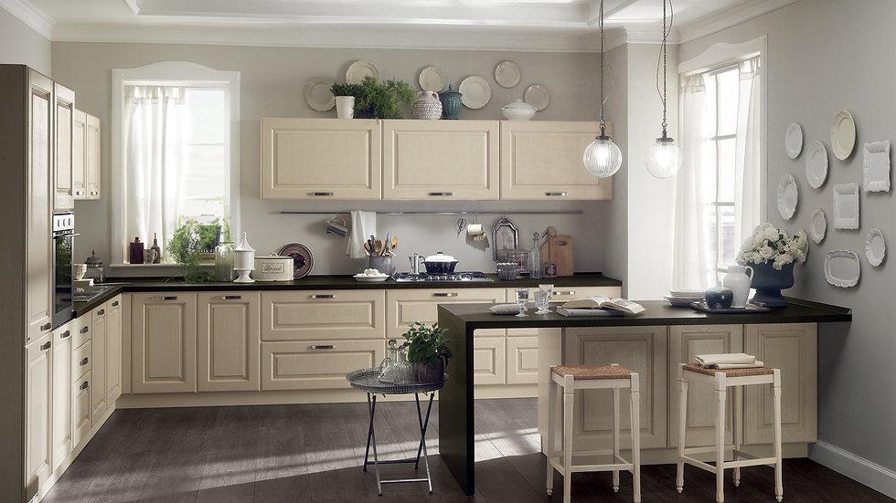 Более простой стиль в этой угловой композиции с функциональными компонентами (плита, мойка и духовка, встроенные в шкаф), рас