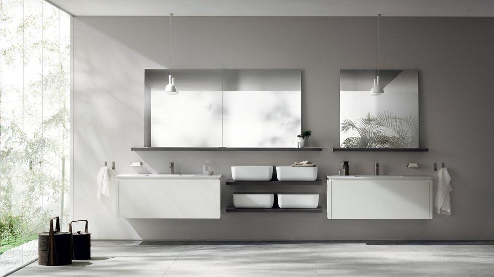 Приветливая, мягкая и непрозрачная форма умывальников идеально сочетается с эстетикой мебели для ванных комнат Qi от Scavolin