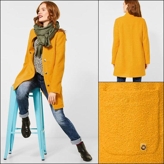 Manteau à bouclettes moutarde