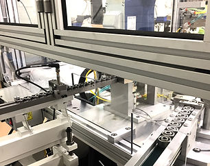Conveyor into machine