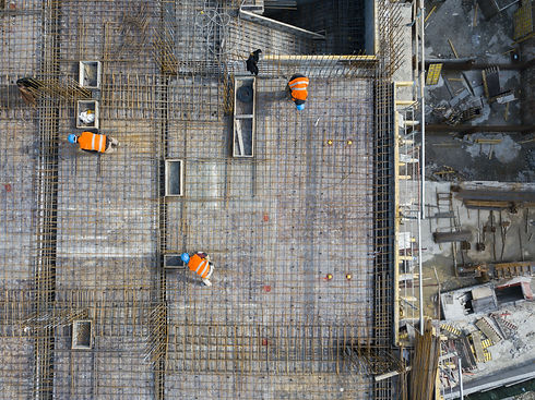 Construction site workers - aerial - Top