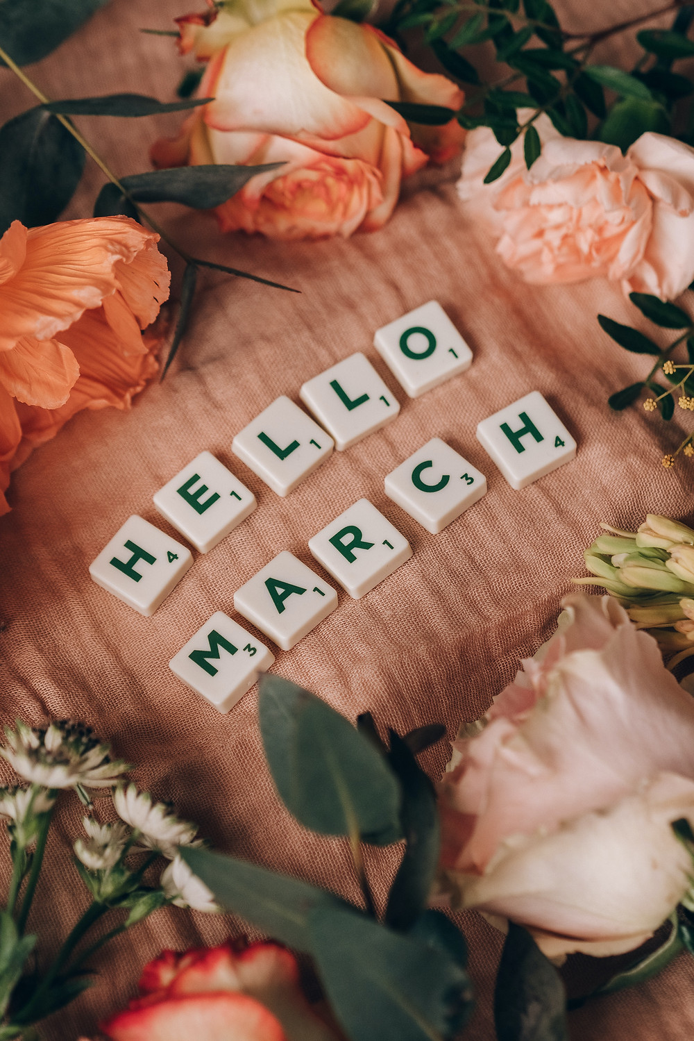 """Flowers """"Hello March"""" spelled out on tiles"""