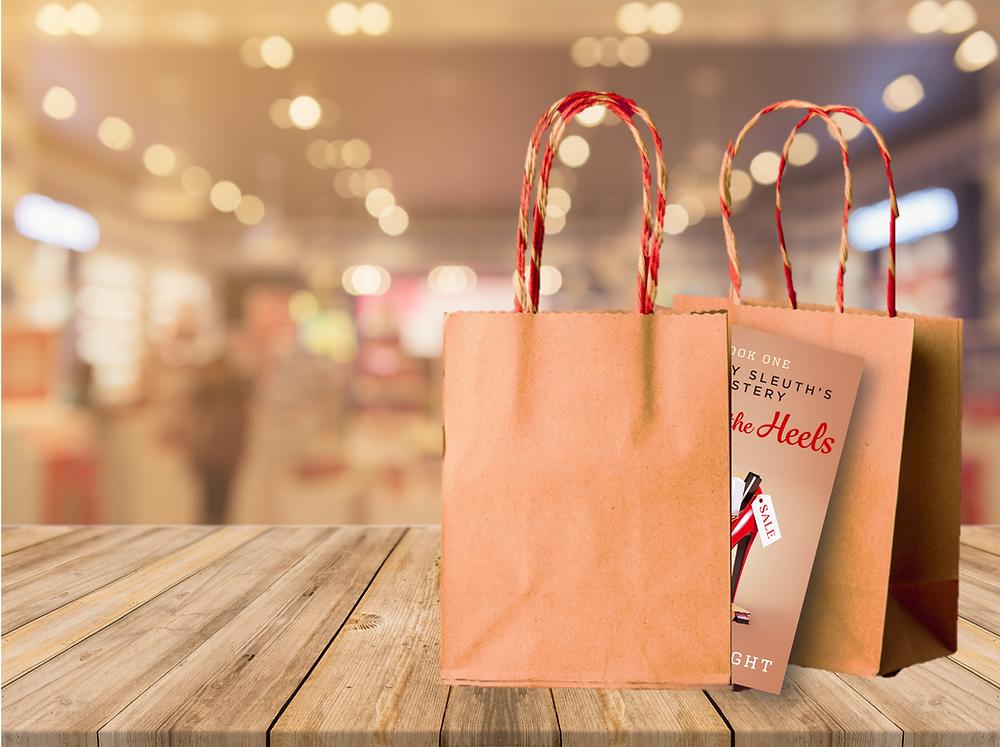 book cover hiding between shopping bags