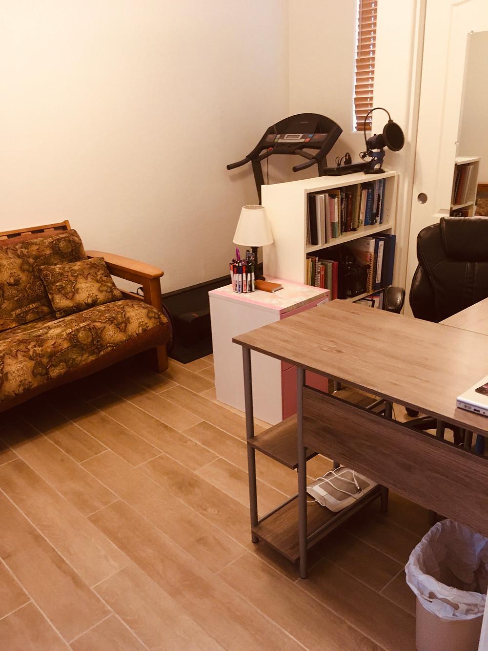 Picture of a desk, small bookcase, & futon