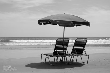 two sunbeds and a parasol