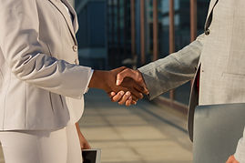 black-businesswoman-shaking-hands-with-m
