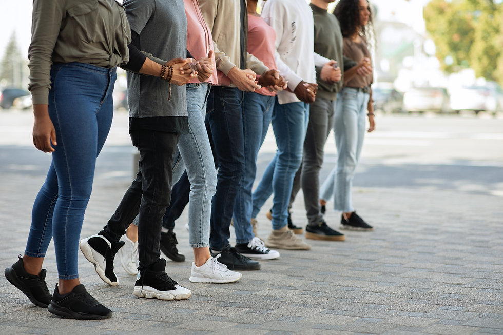 international-group-holding-hands-and-moving-towar-YWW9UGY.jpg