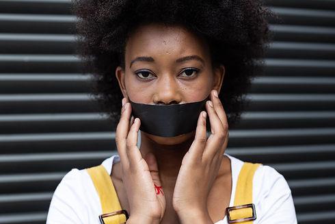 portrait-of-mixed-race-woman-having-blac