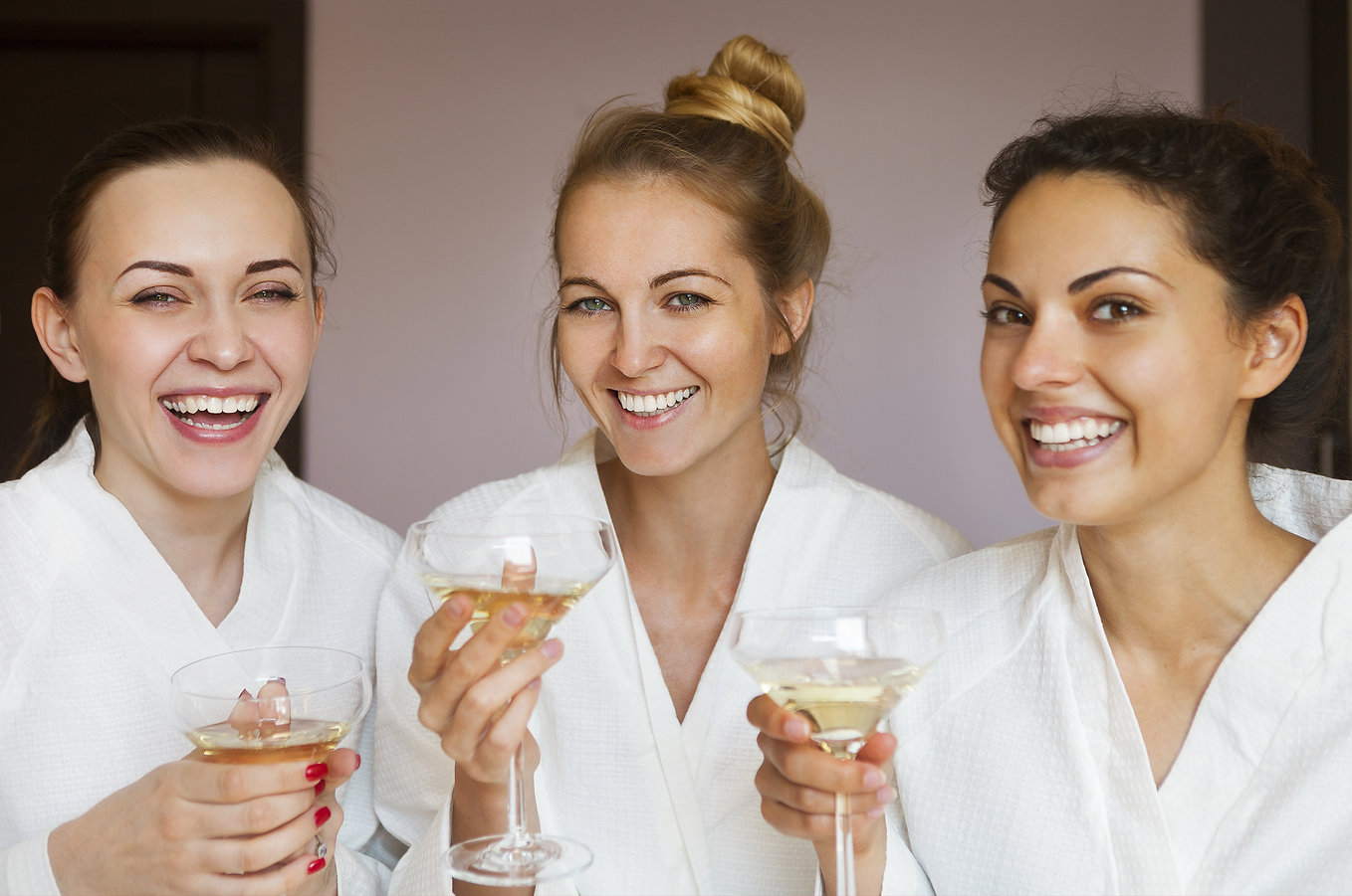 three young women at spa party with champagne
