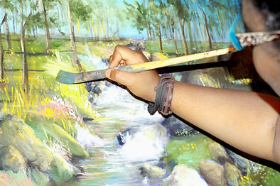 close up of artist painting on a canvas