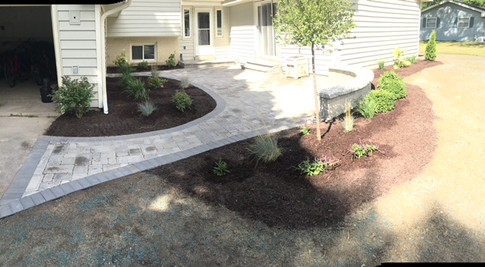 Paver walkway with mulch and plantings
