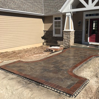 Stamped concrete or pavers?