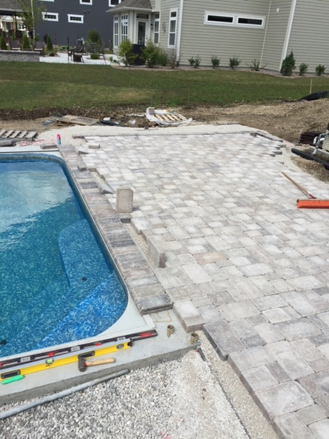 Paver patio around a pool