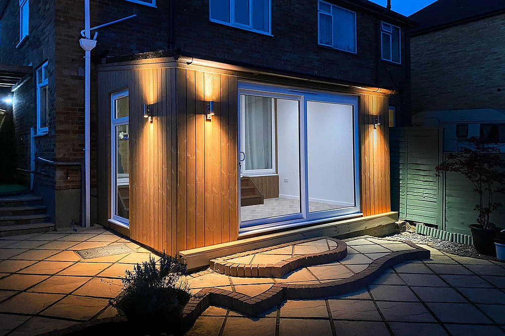 Stunning Attached Garden Room with Exterior Lights at Night