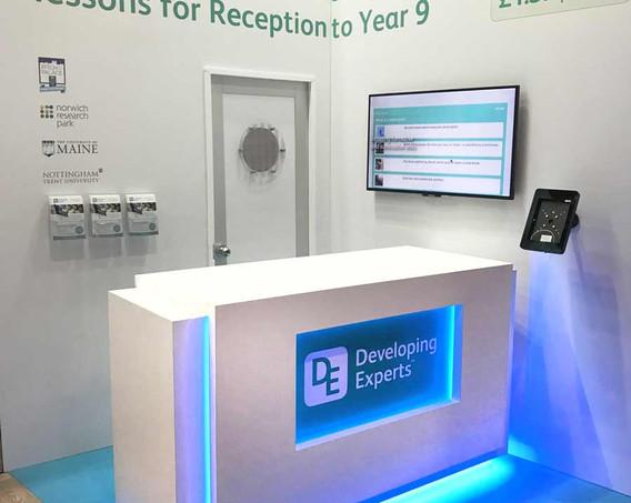 Custom Exhibition Stand Illuminated Counter Developing Experts BETT 2018