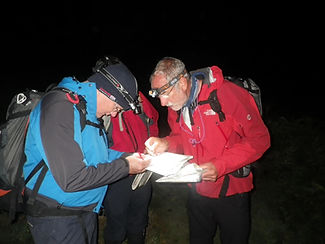 Checking the map at night