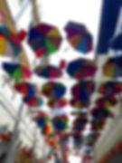 umbrellas street sky.JPG
