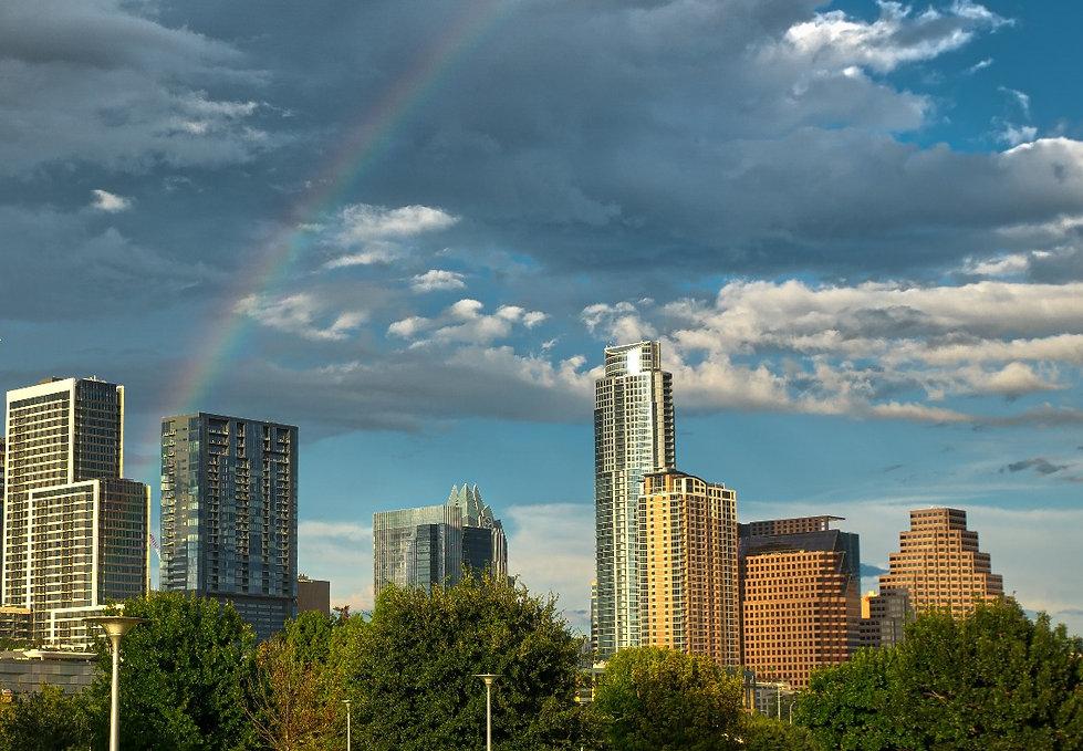 Rainbow over Austin skyline.