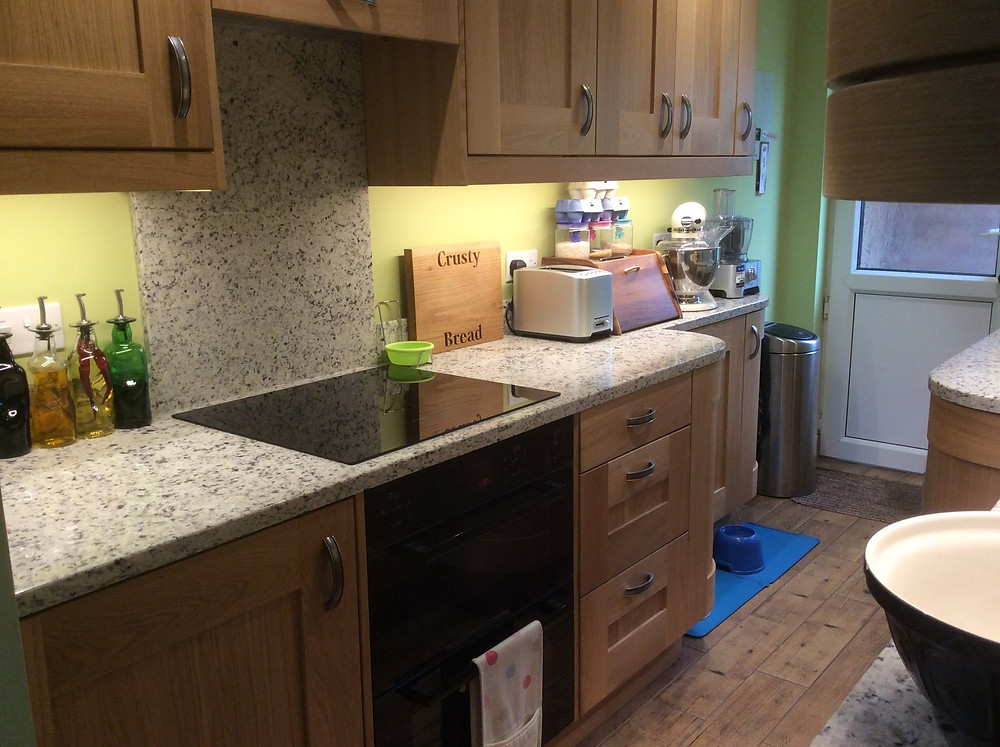 I am absolutely delighted with my new kitchen