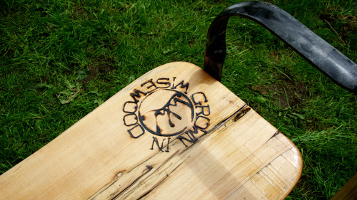 'Grown in Wisewood' Brand on a bench