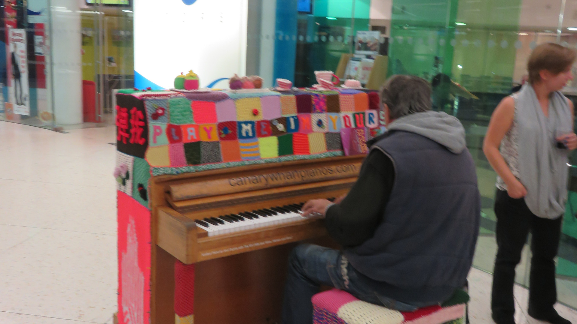 A member of the public plays the piano
