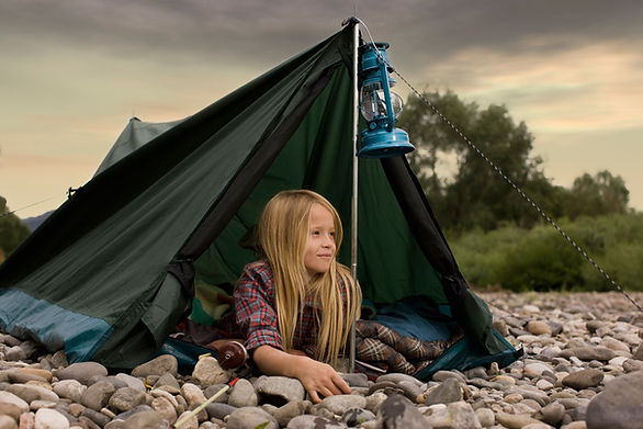Girl in tent with lantern